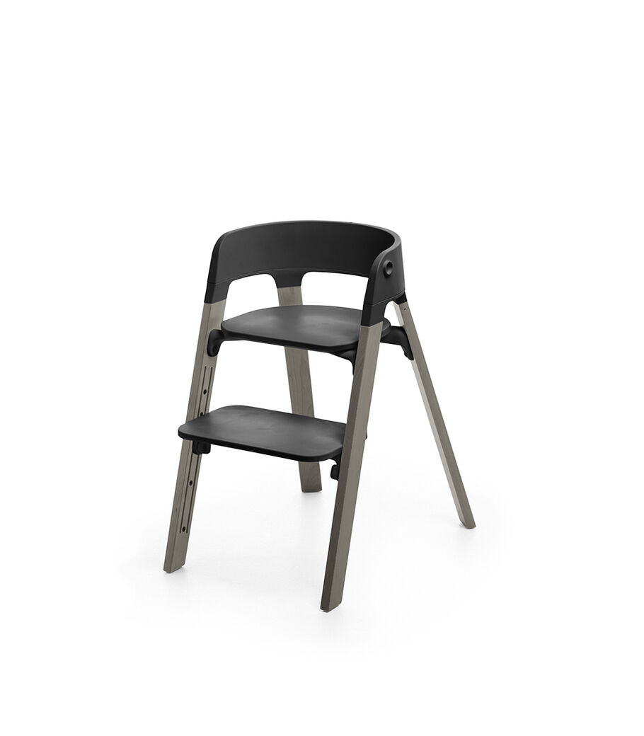 Stokke® Steps™ Chair, Beech Hazy Grey with Black Seat. Footrest high.