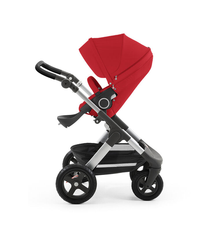Stokke® Trailz™ with silver chassis and Stokke® Stroller Seat, Red. Leatherette Handle. Terrain Wheels.