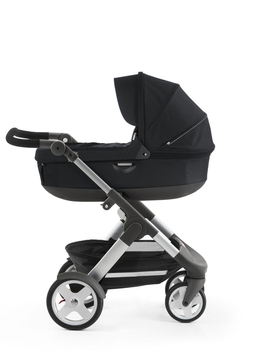 Stokke® Trailz™ with Stokke® Stroller Carry Cot, Black. Classic Wheels.
