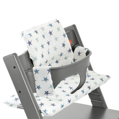 Stokke Care Changing Table Tripp Trapp® Storm Grey with Baby Set and Aqua Star cushion. Detail.