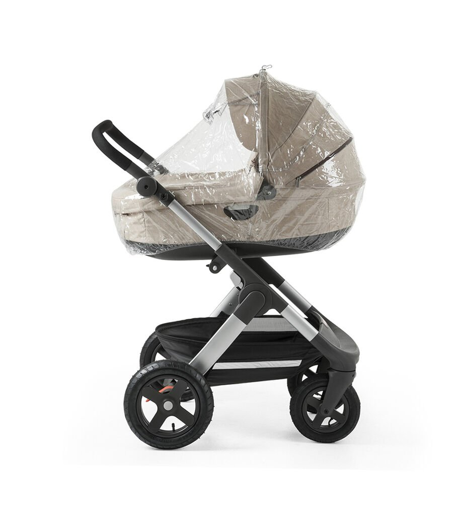Chassis with Stokke® Stroller Carry Cot, Beige Melange. Rain Cover.