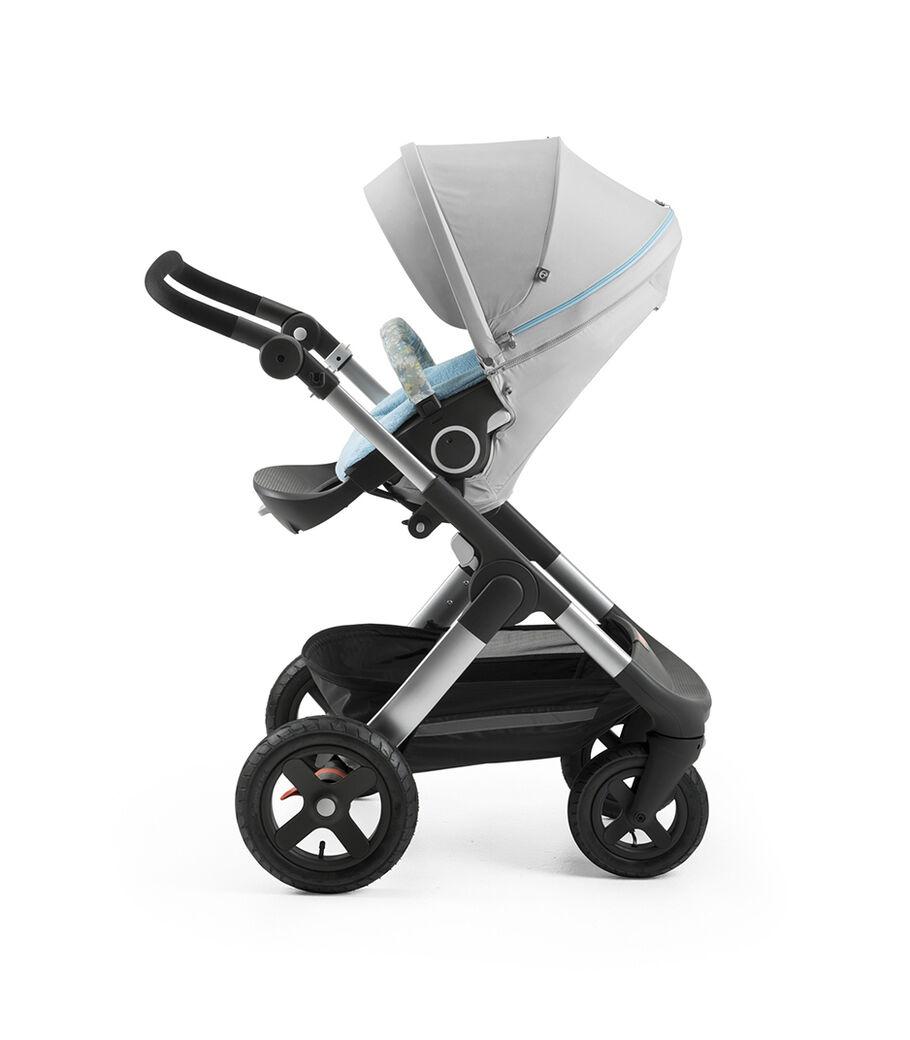 Stokke® Trailz™ with Stokke® Stroller Seat and Flora Blue Summer Kit.