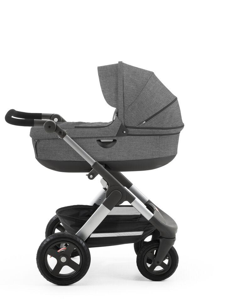 Stokke® Trailz™ with Stokke® Stroller Carry Cot Black Melange.
