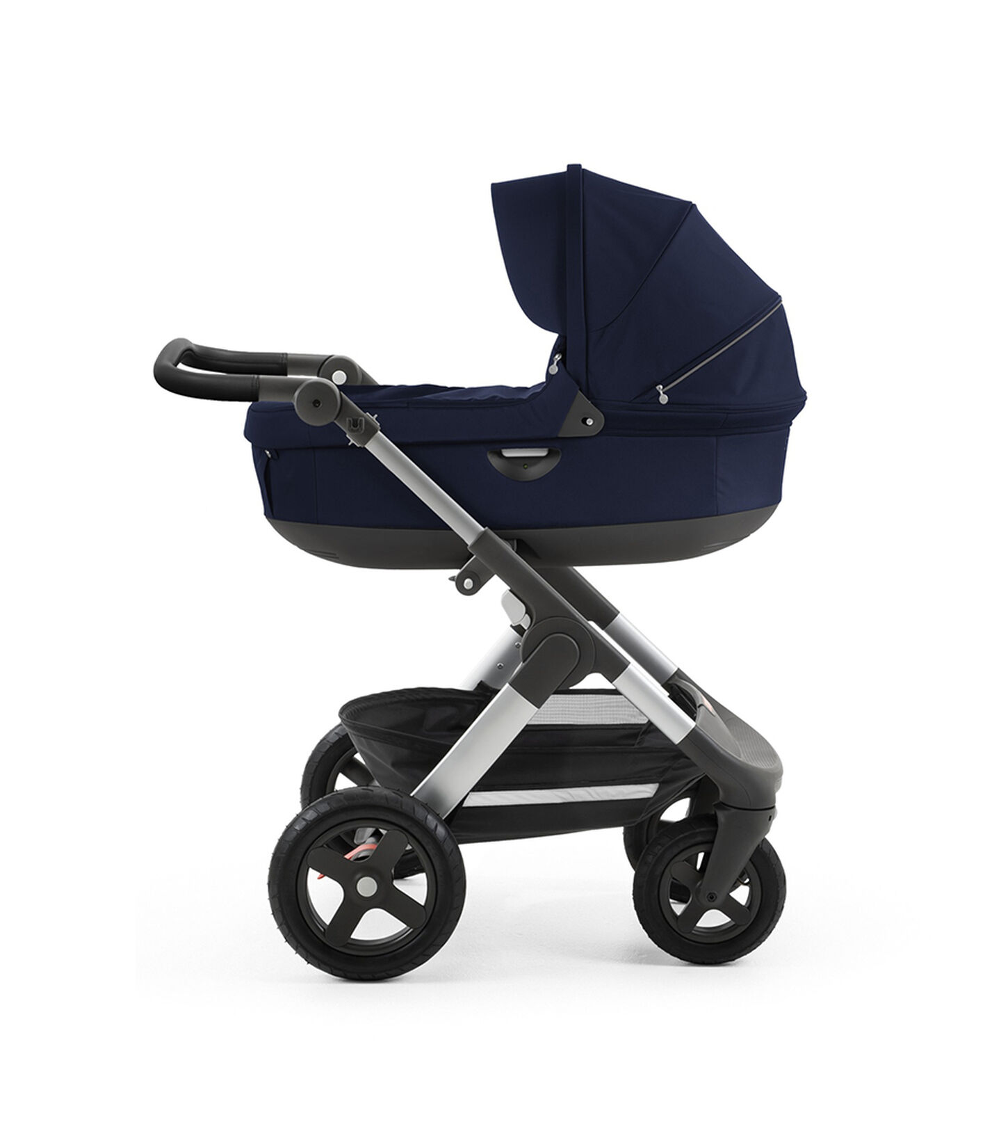 Stokke® Trailz™ with silver chassis  and Stokke® Stroller Carry Cot, Deep Blue. Leatherette Handle.