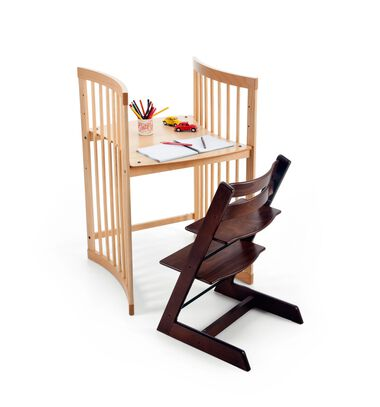 Stokke® Care™ small desk Natural, with Tripp Trapp® Walnut Brown.