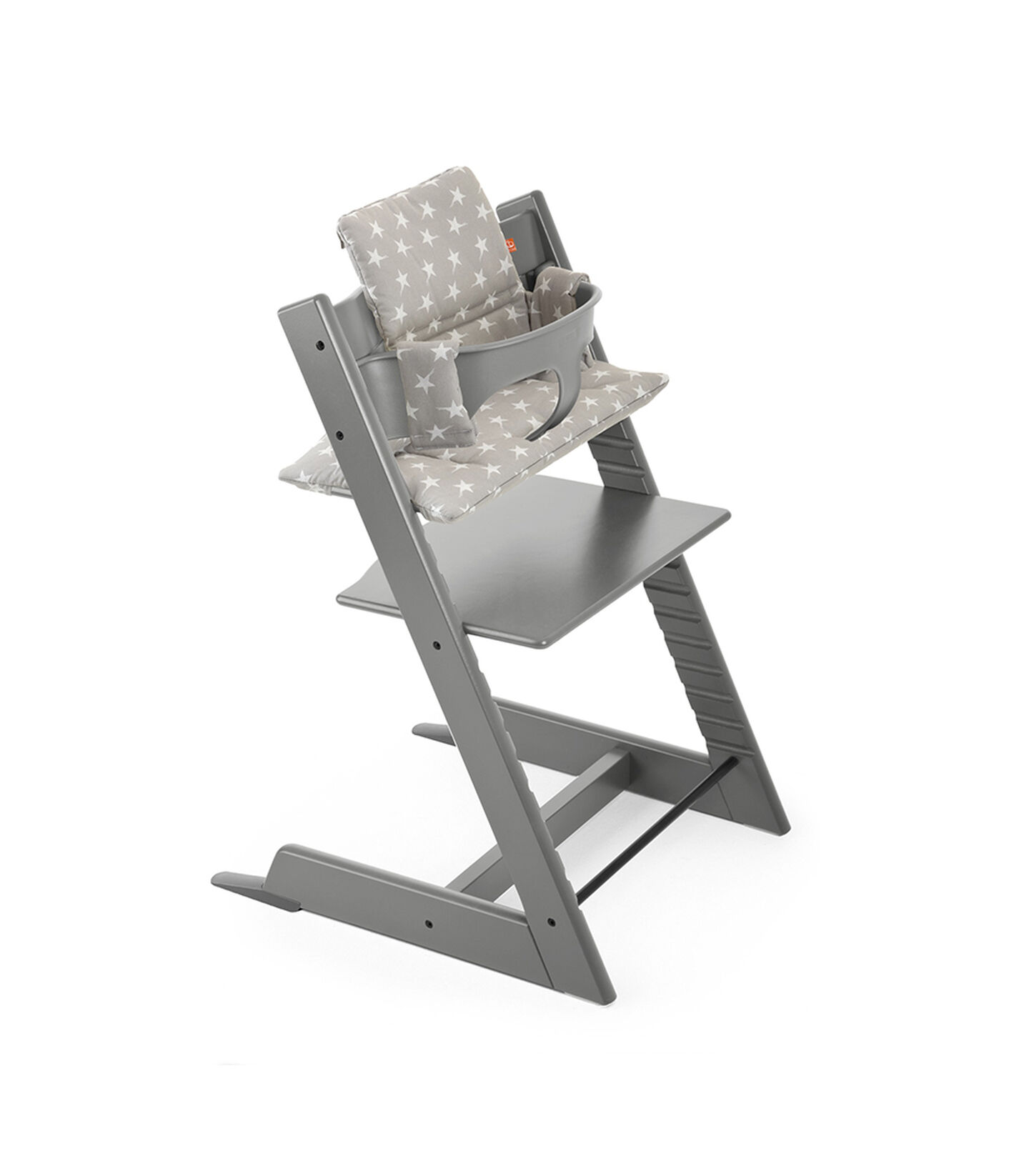 Tripp Trapp® Storm Grey with Baby Set and Grey Star Cushion.