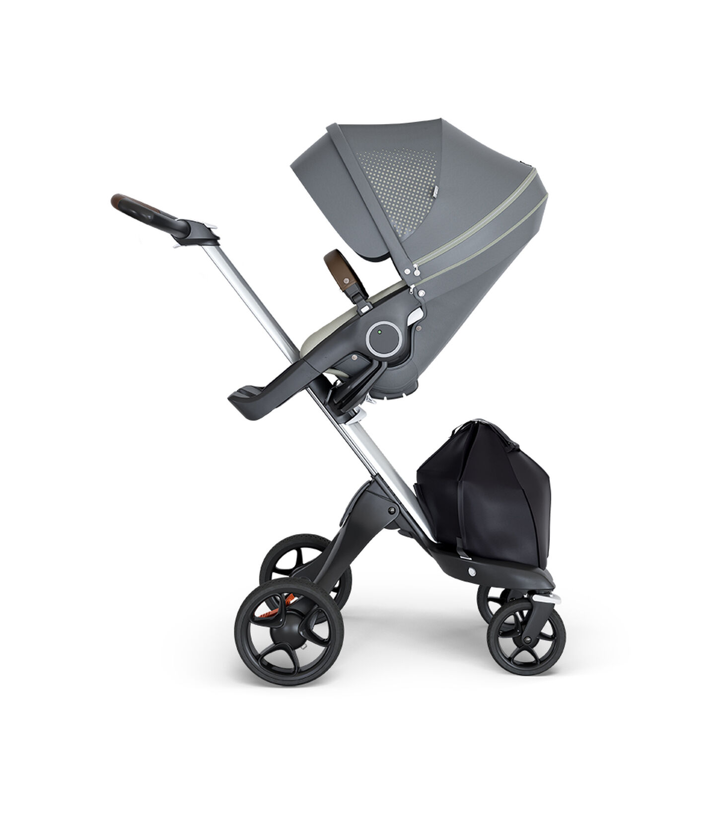 Stokke® Xplory® wtih Silver Chassis and Leatherette Brown handle. Stokke® Stroller Seat Athleisure Green. view 1