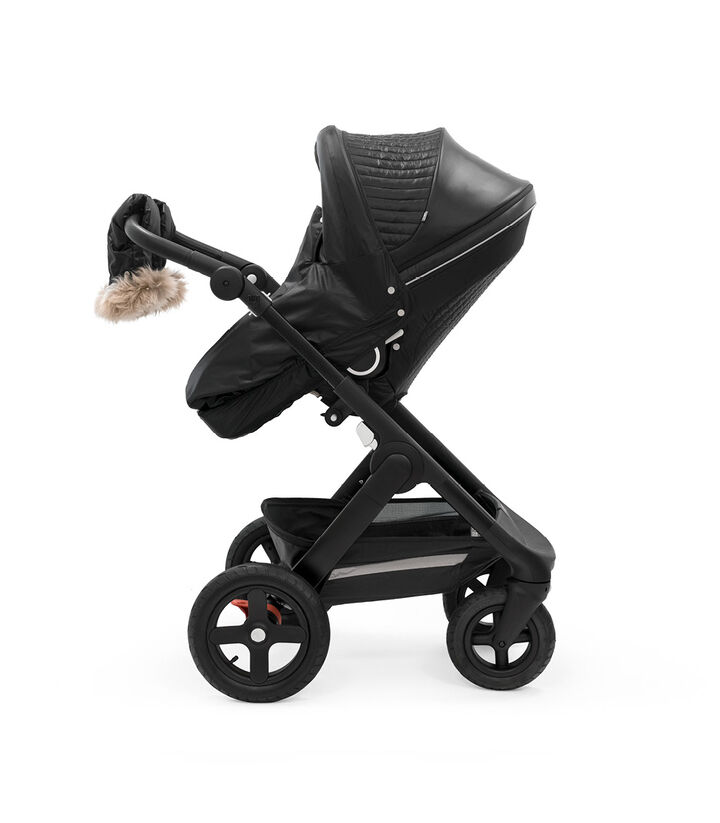 Stokke® Trailz™ Black Chassis with Stokke® Stroller Seat and Onyx Black Winter Kit. view 1
