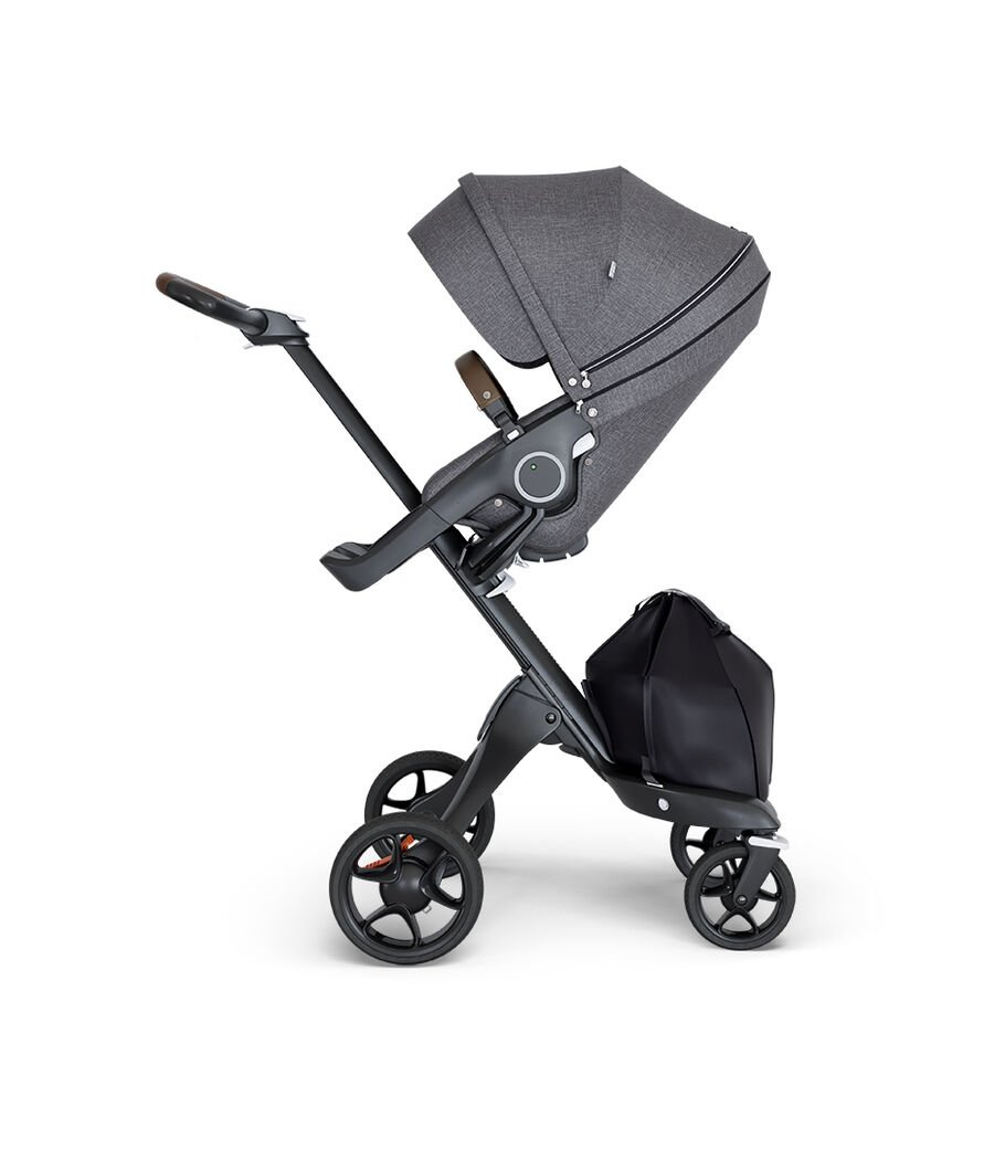 Stokke® Xplory® wtih Black Chassis and Leatherette Brown handle. Stokke® Stroller Seat Black Melange.