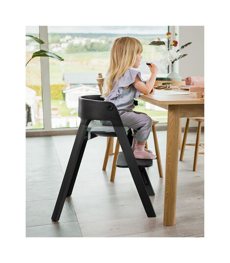 Stokke® Steps™ high chair. Oak White with Black seat. Oak Black with White seat.