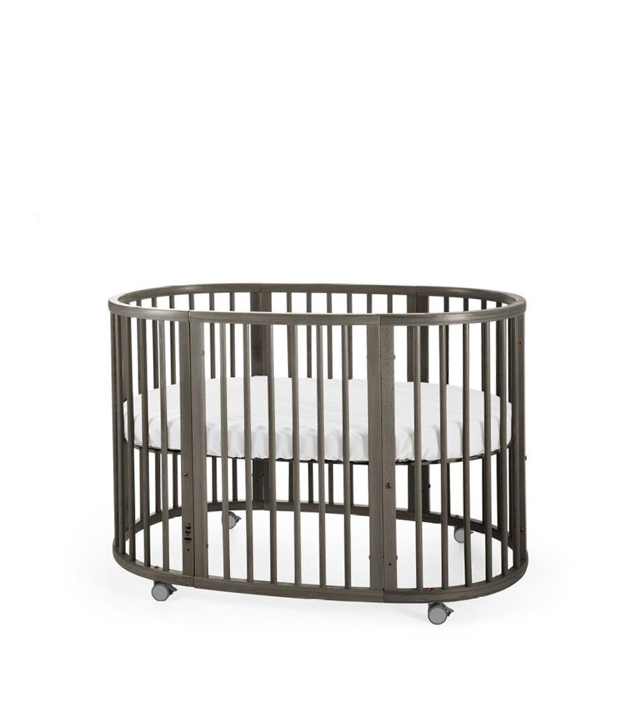 Stokke® Sleepi™ Bed Hazy Grey. Mattress high.