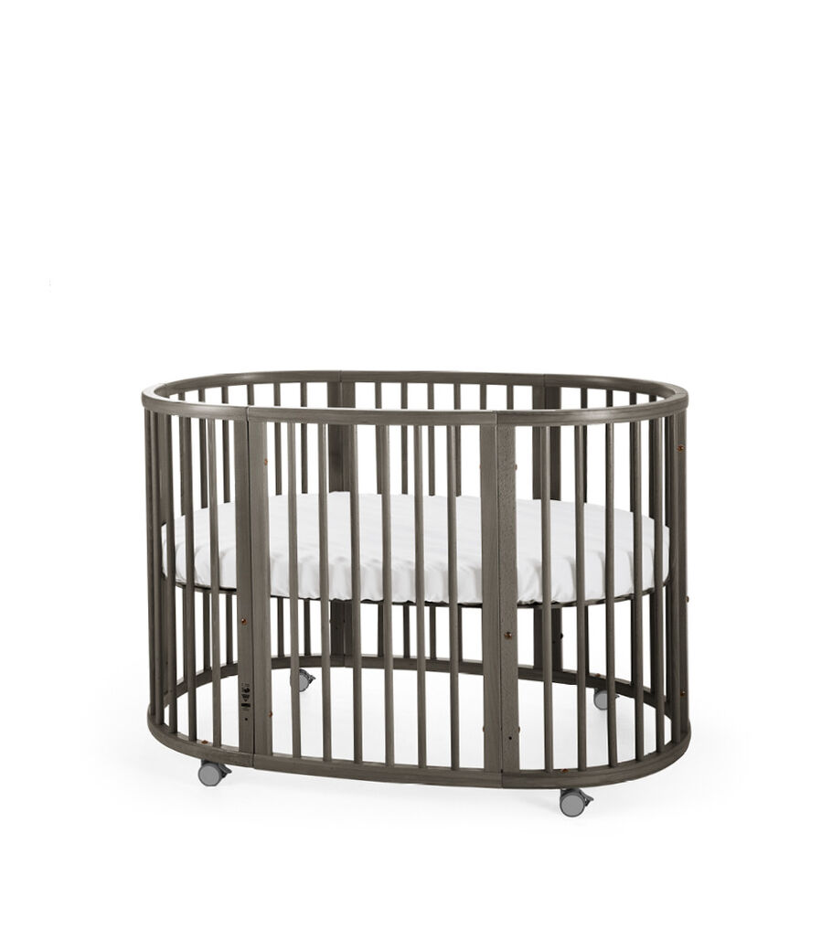 Stokke® Sleepi™ Bed Hazy Grey. Mattress high. view 4