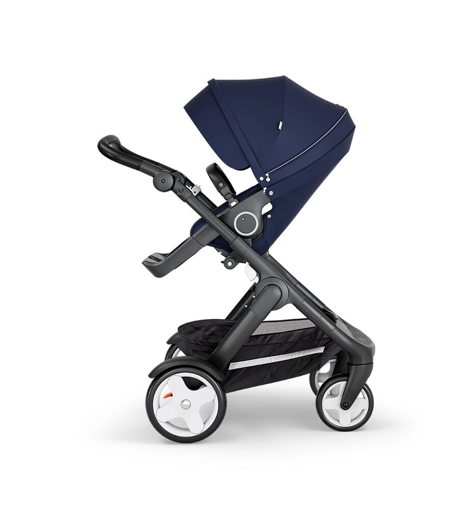 Stokke® Trailz™ with Black Chassis, Black Leatherette and Classic Wheels. Stokke® Stroller Seat, Deep Blue.