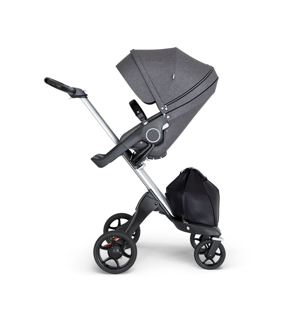 Stokke® Xplory® wtih Silver Chassis and Leatherette Black handle. Stokke® Stroller Seat Black Melange. view 22
