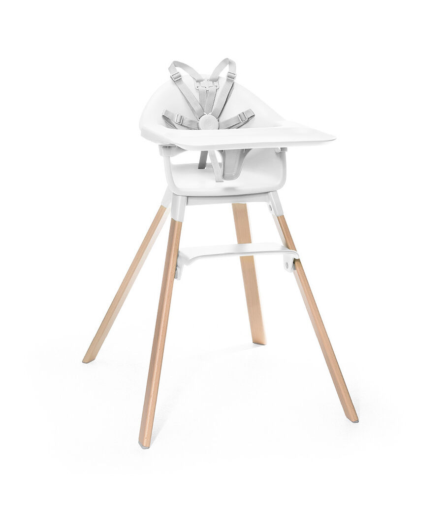 Stokke® Clikk™ High Chair. Natural Beech wood and White plastic parts. Harness and Tray attached.