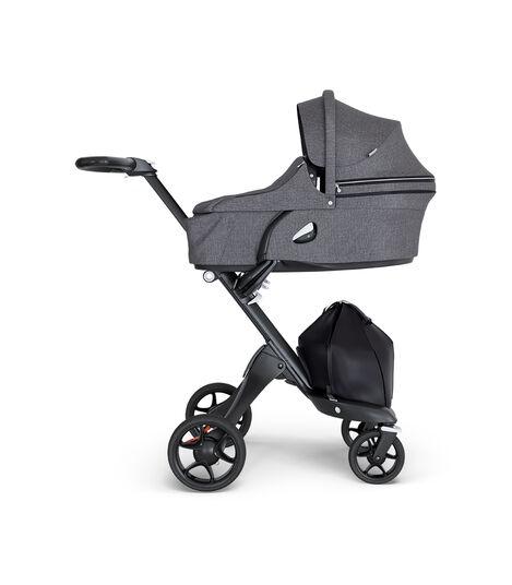 Stokke® Xplory® wtih Black Chassis and Leatherette Black handle. Stokke® Stroller Carry Cot Black Melange.