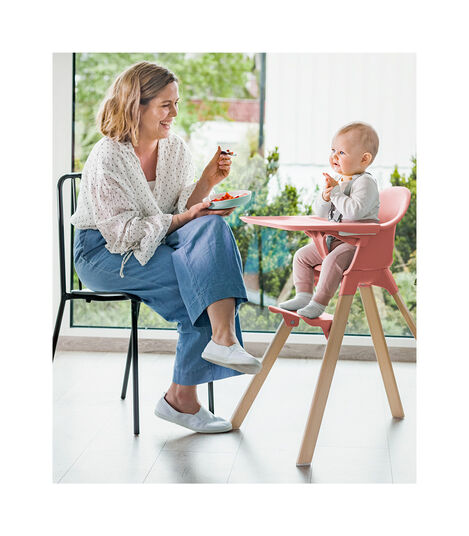 Stokke® Clikk™ High Chair. Natural Beech wood. Sunny Coral plastic parts.