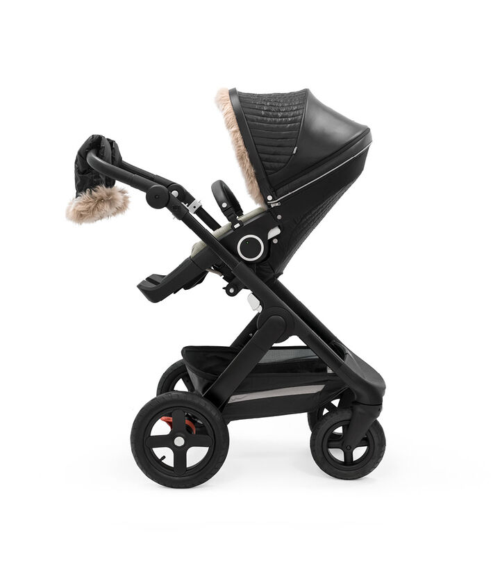 Stokke® Trailz™ Black Chassis with Stokke® Stroller Seat and Onyx Black Winter Kit.