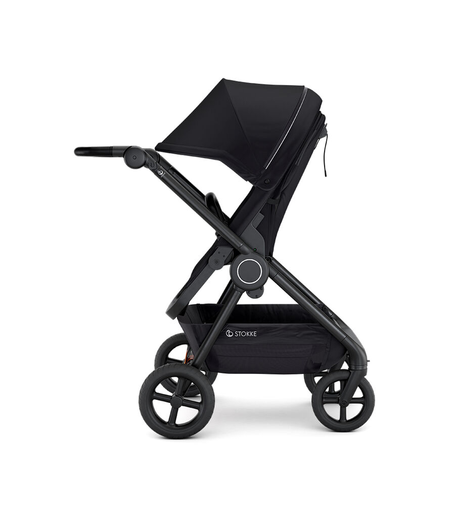 Stokke® Beat™ with Seat. Black. Parent facing. Extended Canopy.