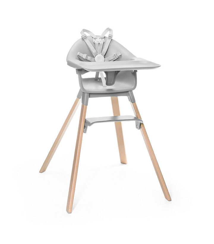 Stokke® Clikk™ High Chair. Natural Beech wood and Cloud Grey plastic parts. Stokke® Harness and Tray attached.