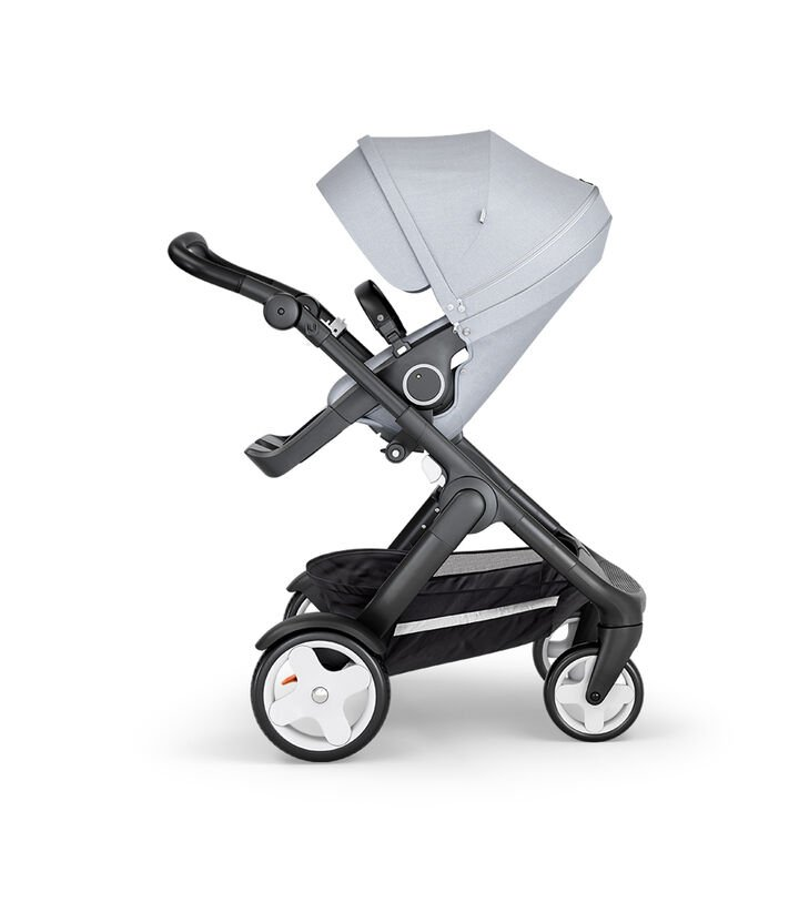 Stokke® Trailz™ with Black Chassis, Black Leatherette and Classic Wheels. Stokke® Stroller Seat, Grey Melange.