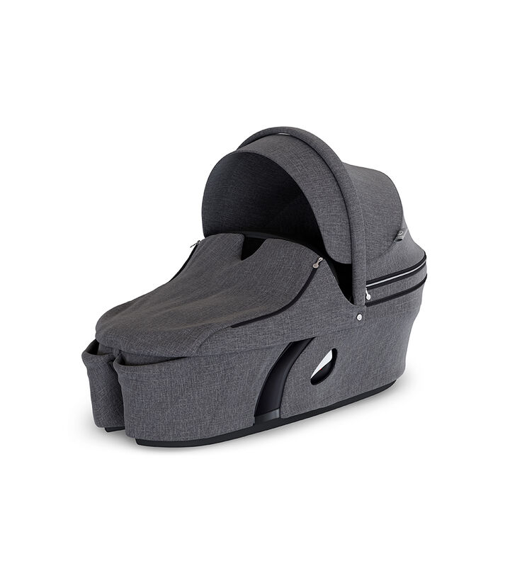 Stokke® Xplory® Carry Cot Black Melange. With Storm Cover. view 1
