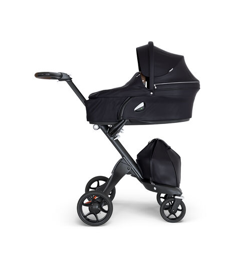 Stokke® Xplory® wtih Black Chassis and Leatherette Brown handle. Stokke® Stroller Carry Cot Black.
