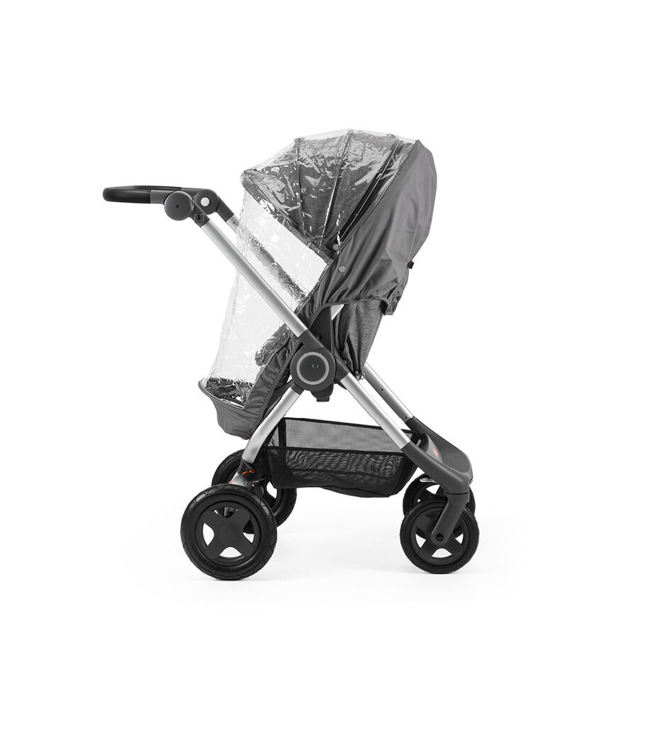 Stokke® Scoot™ Black Melange. Leatherette handle. Parent facing, active position. Rain Cover.