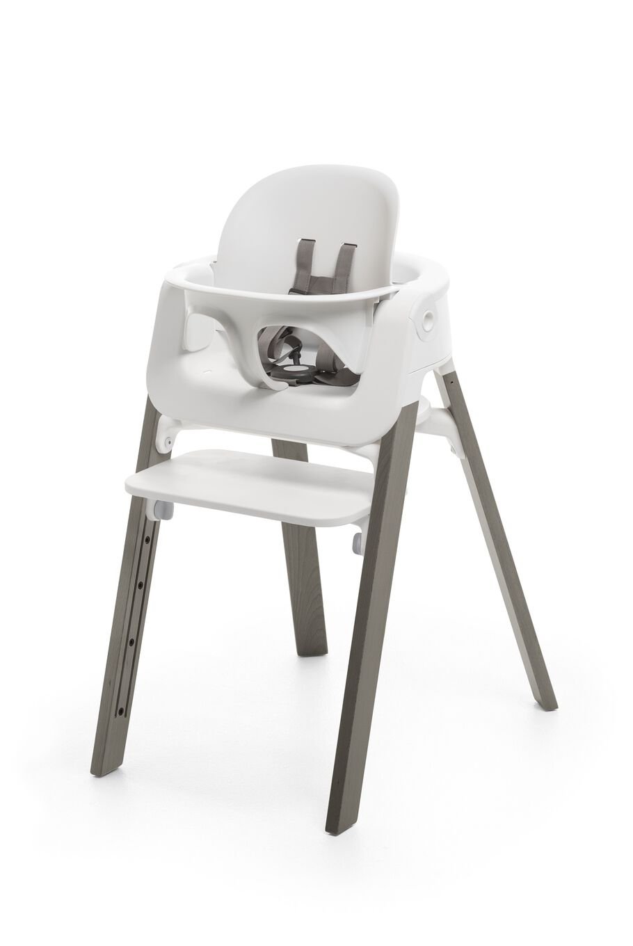 Stokke® Steps™ Hazy Grey highchair with Baby Set White.