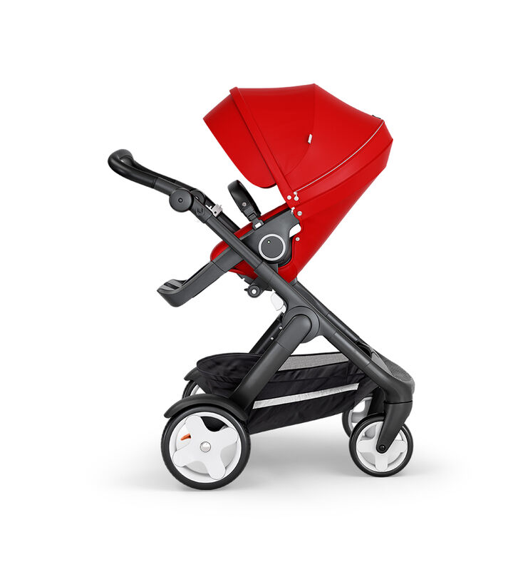 Stokke® Trailz™ with Black Chassis, Black Leatherette and Classic Wheels. Stokke® Stroller Seat, Red.