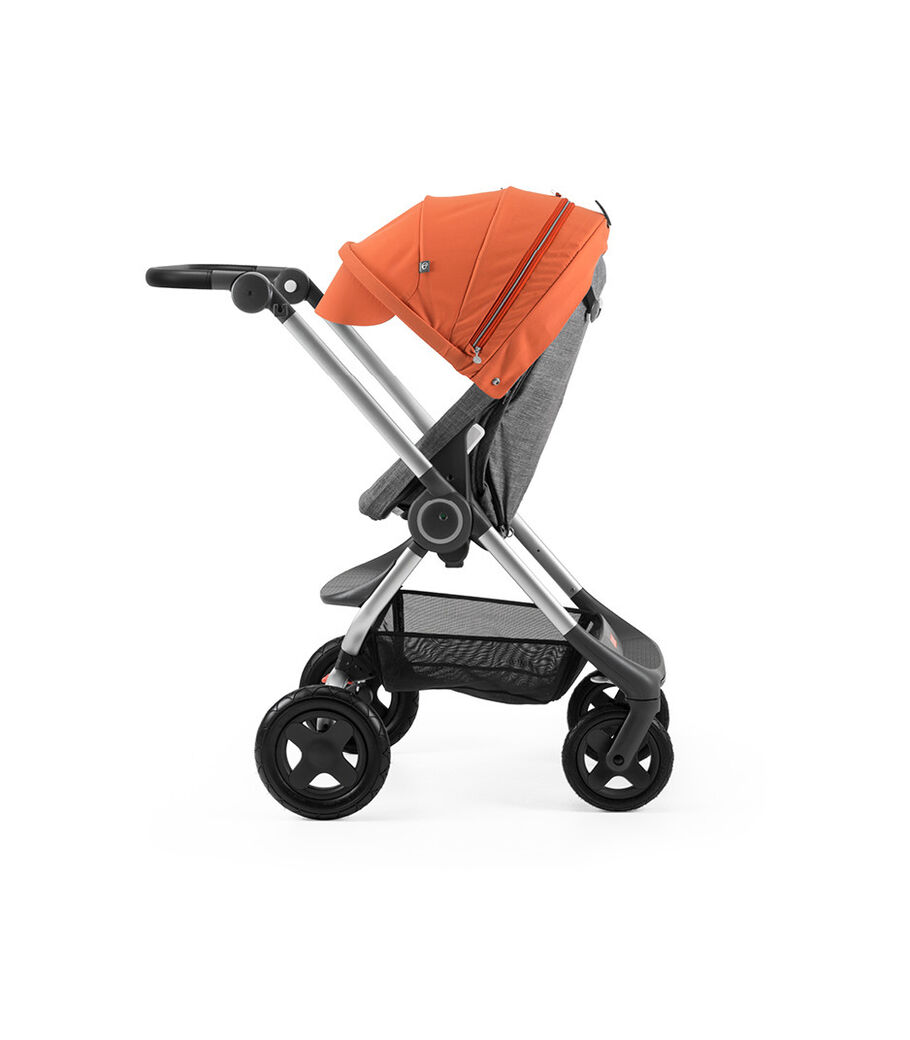 Stokke® Scoot™ Black Melange with Orange Canopy. Parent facing, active position.