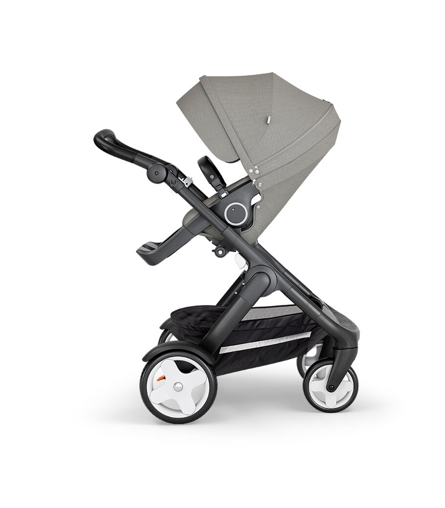 Stokke® Trailz™ with Black Chassis, Black Leatherette and Classic Wheels. Stokke® Stroller Seat, Brushed Grey.