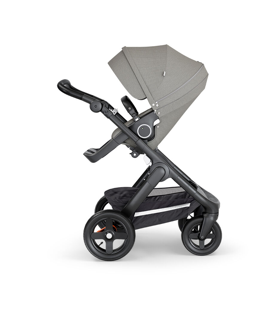 Stokke® Trailz™ with Black Chassis, Black Leatherette and Terrain Wheels. Stokke® Stroller Seat, Brushed Grey.