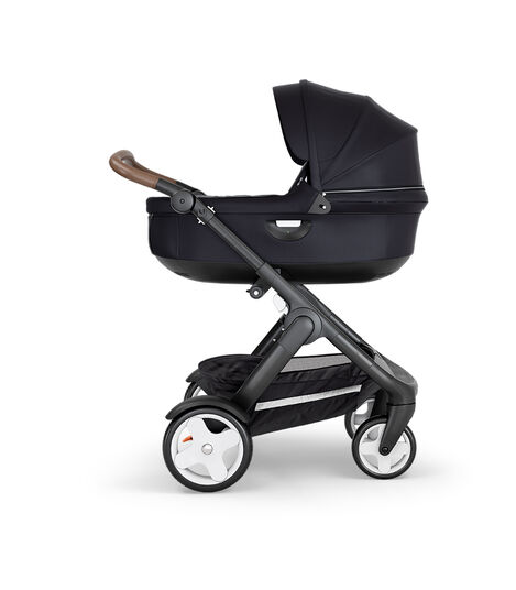 Stokke® Trailz™ with Black Chassis, Brown Leatherette and Classic Wheels. Stokke® Stroller Carry Cot, Black. view 3