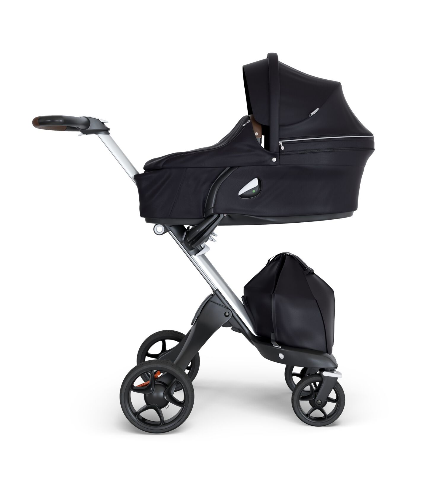 Stokke® Xplory® wtih Silver Chassis and Leatherette Brown handle. Stokke® Stroller Carry Cot Black.
