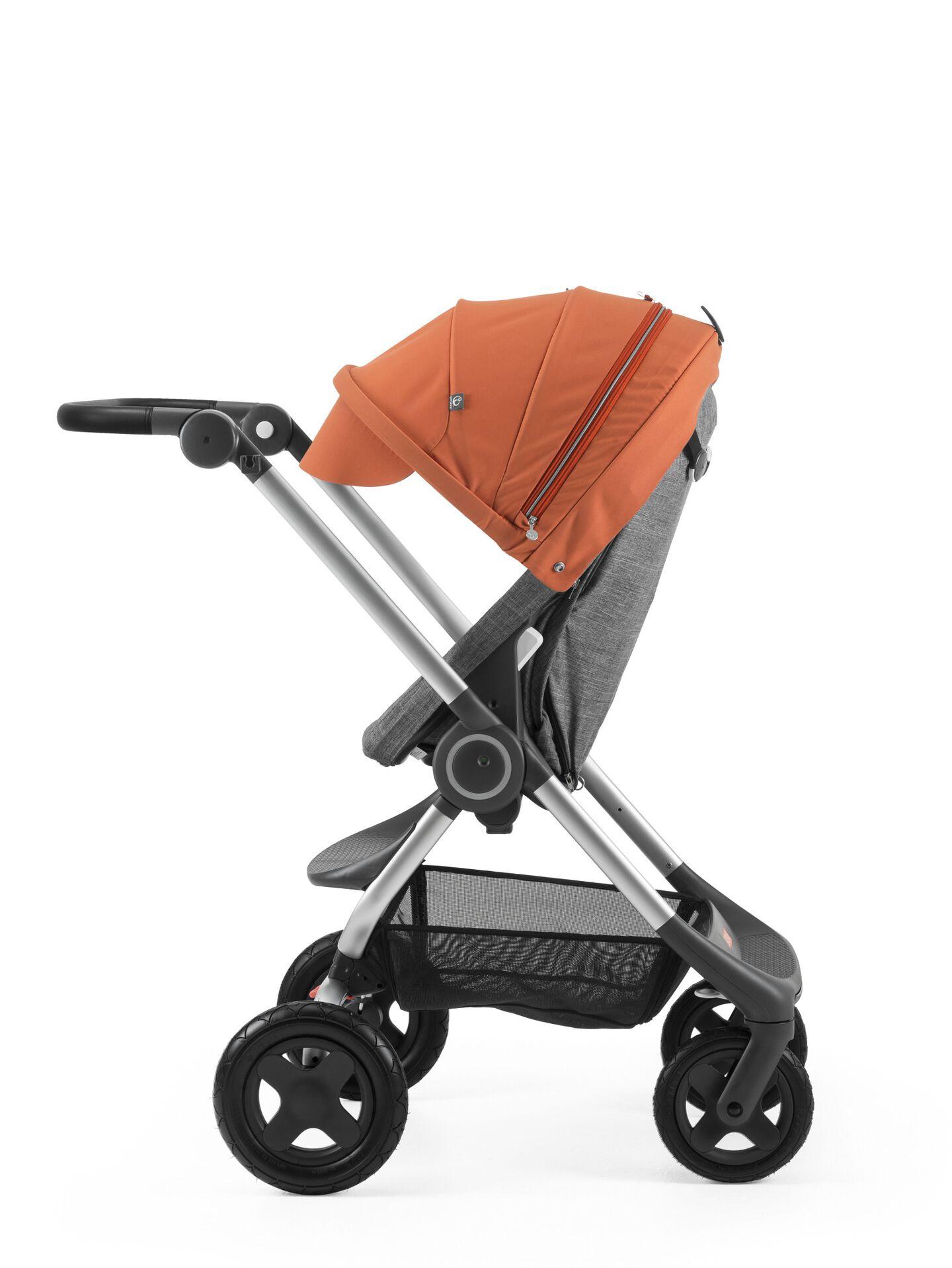Stokke® Scoot™ Black Melange with Orange Canopy. Parent facing, active position.