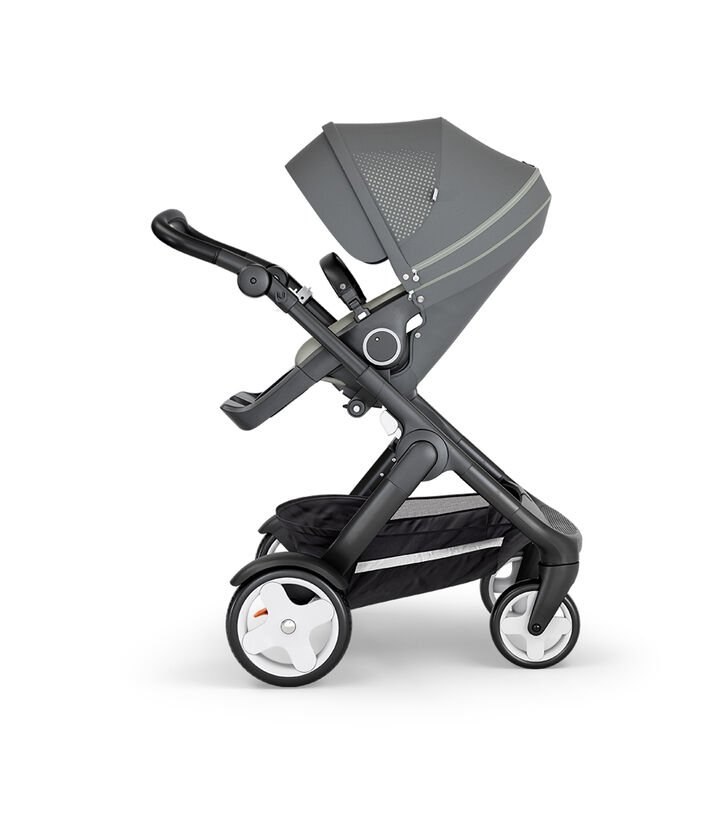 Stokke® Trailz™ with Black Chassis, Black Leatherette and Classic Wheels. Stokke® Stroller Seat, Athleisure Green.