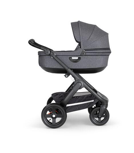 Stokke® Trailz™ with Black Chassis, Black Leatherette and Terrain Wheels. Stokke® Stroller Carry Cot, Black Melange.
