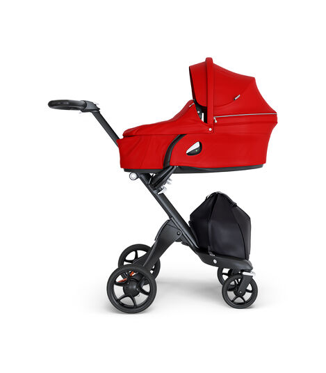 Stokke® Xplory® wtih Black Chassis and Leatherette Black handle. Stokke® Stroller Carry Cot Red. view 3