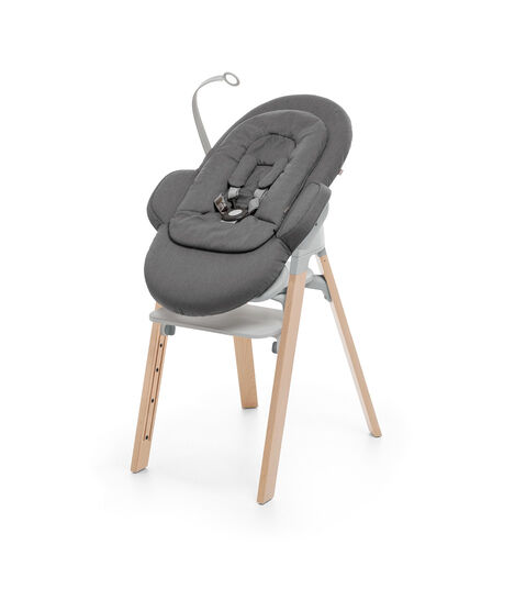 Stokke® Steps™ Natural and Light Grey plastic with Stokke® Steps Bouncer in Deep Grey.. view 3