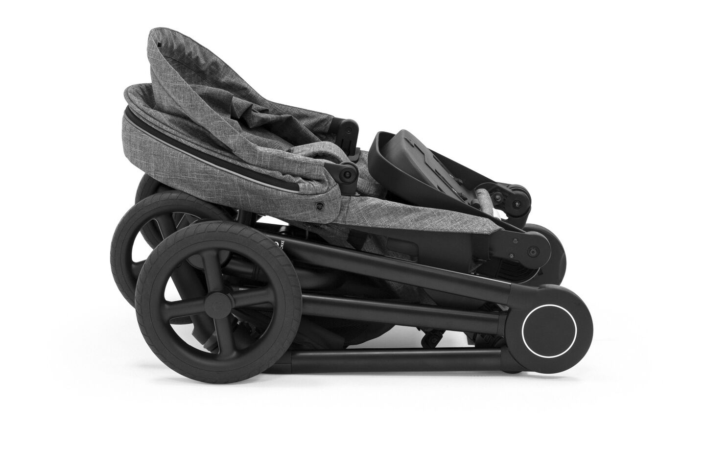 Stokke® Beat™ Black Melange. Folded.