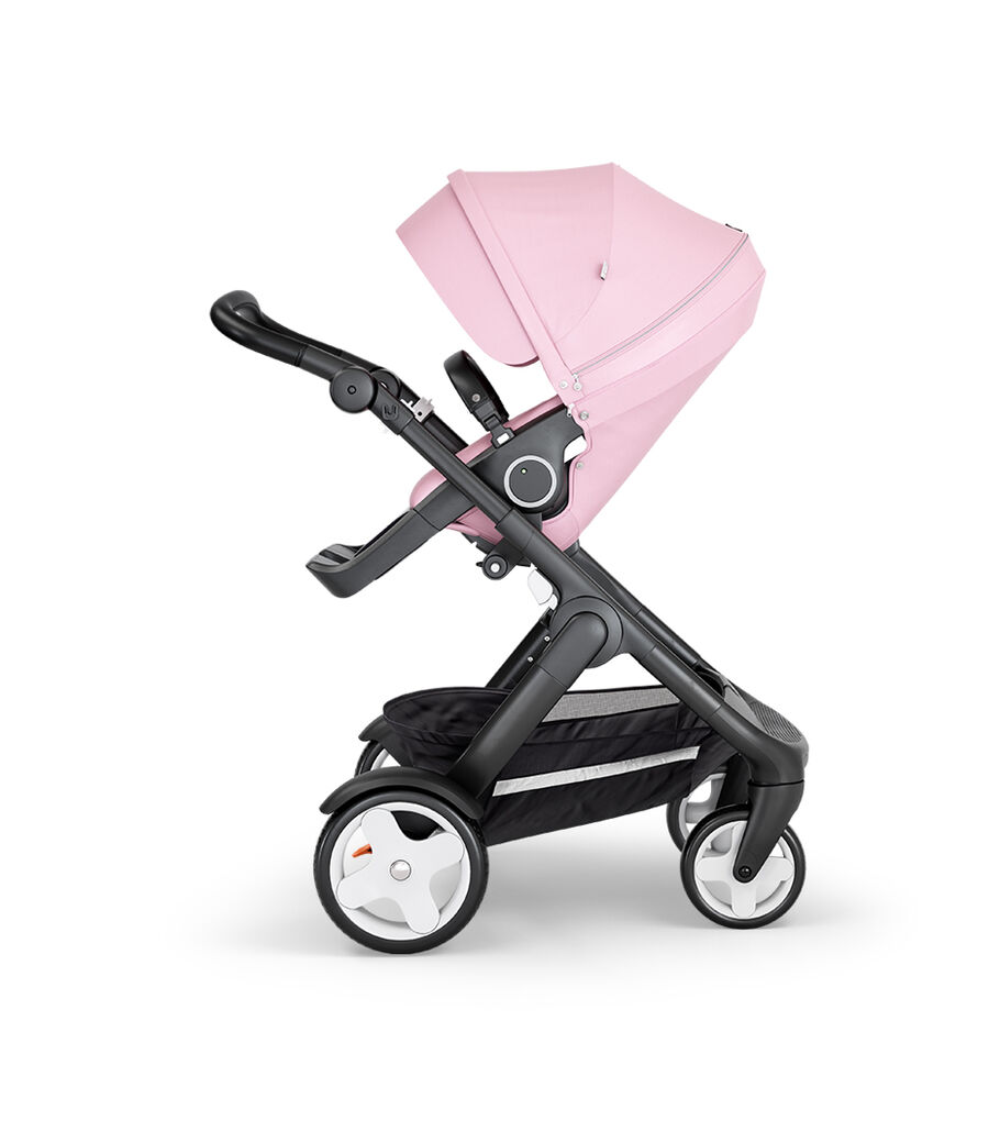 Stokke® Trailz™ with Black Chassis, Black Leatherette and Terrain Wheels. Stokke® Stroller Seat, Lotus Pink view 6