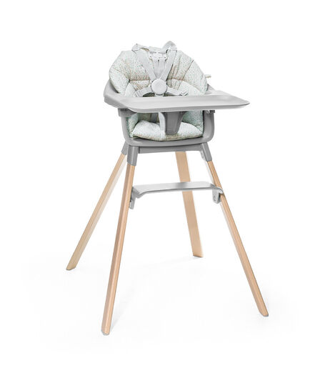 Stokke® Clikk™ High Chair. Natural Beech wood and Cloud Grey plastic parts including Tray. Cushion Grey Sprinkle and Harness.