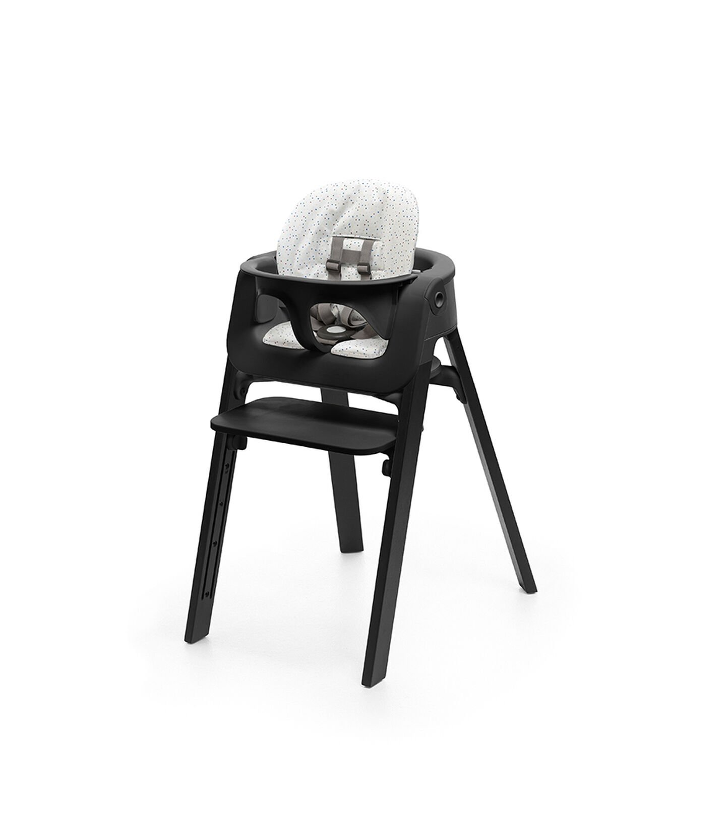 Stokke® Steps™ Chair Oak Black, with Baby Set Black and Cushion Soft Sprinkle.