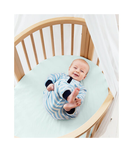 Stokke® Sleepi™ Mini Bed, Natural with Fitted Sheet Powder Blue. view 2