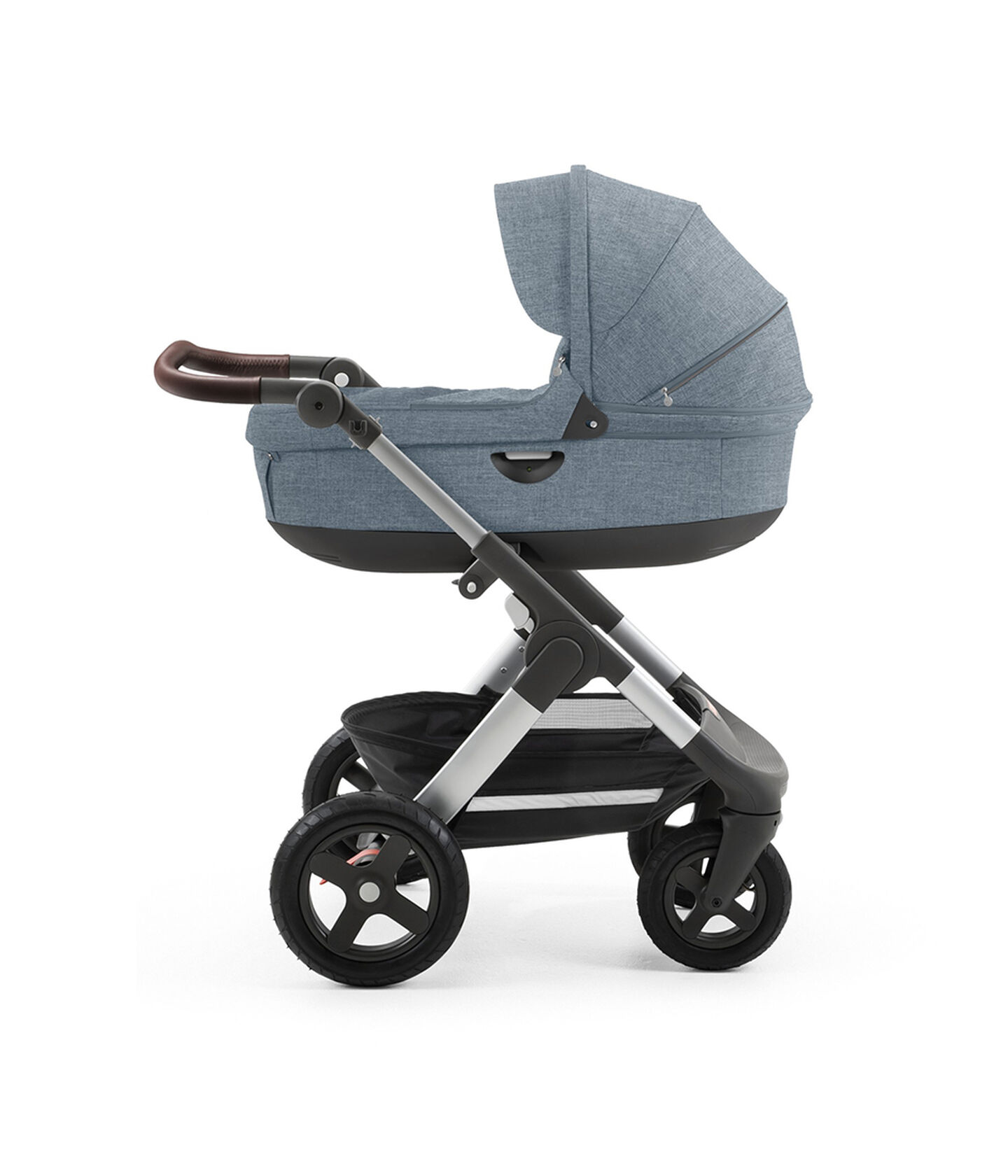 Stokke® Trailz™ with silver chassis and Stokke® Stroller Carry Cot, Urban Blue. Terrain Wheels.