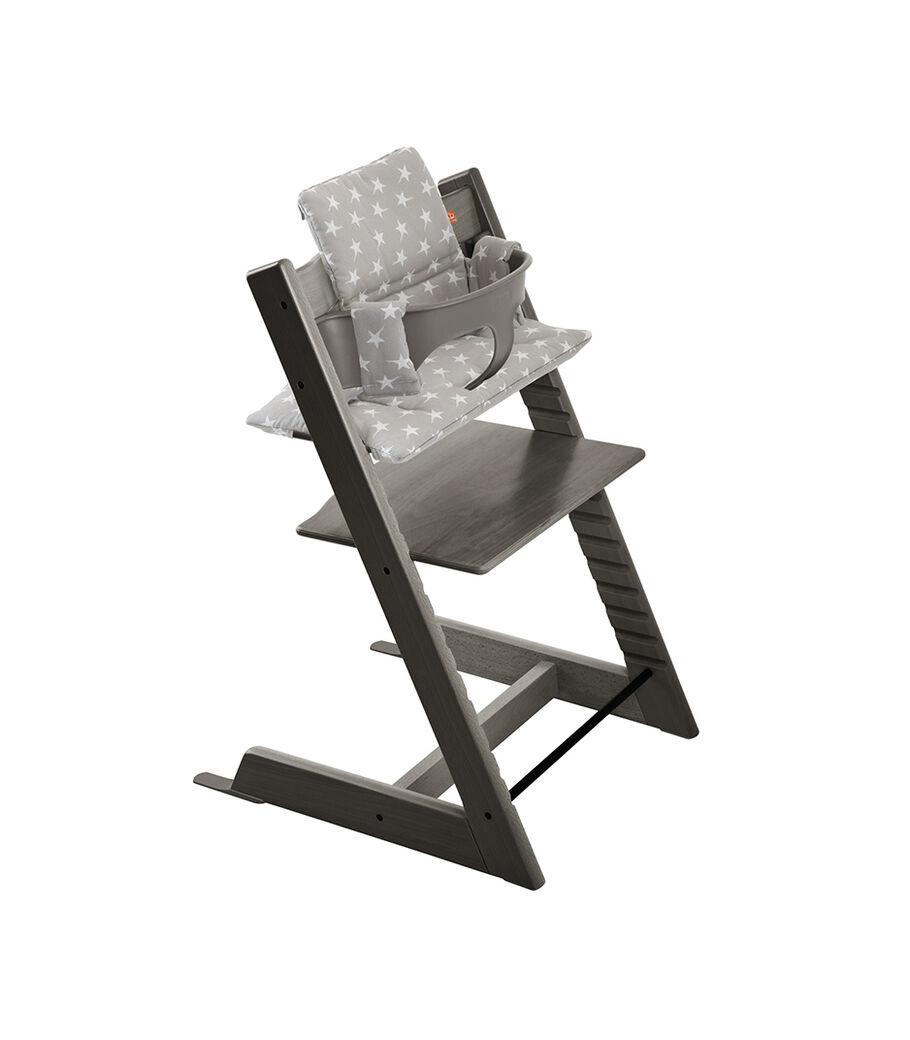 Tripp Trapp® Hazy Grey with Baby Set and Grey Stars Cushion.