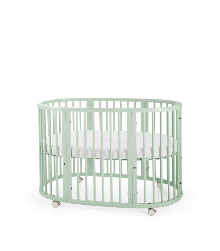 Stokke® Sleep™ Bed. Mint. Mattress high.