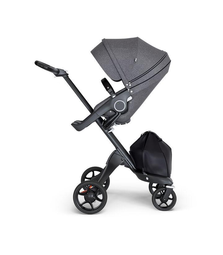 Stokke® Xplory® wtih Black Chassis and Leatherette Black handle. Stokke® Stroller Seat Black Melange. view 1