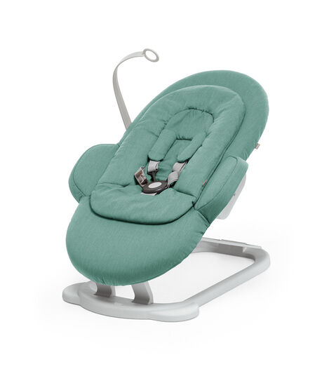 Stokke® Steps Bouncer in Cool Jade.